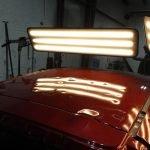 red-hail-damaged-car-under-pdr-lights