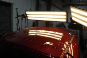 red-hail-damaged-car-under-pdr-lights